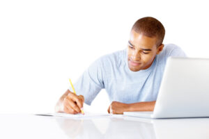 Young modern African American college student studying with the help of a laptop